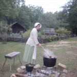 Emma stirs apple butter at Schiele's Backcountry Farm