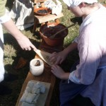 Tasha demonstrating American Indian cooking technique